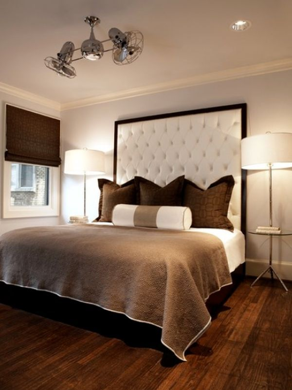 Elegant and warm bedroom with a tufted tall headboard