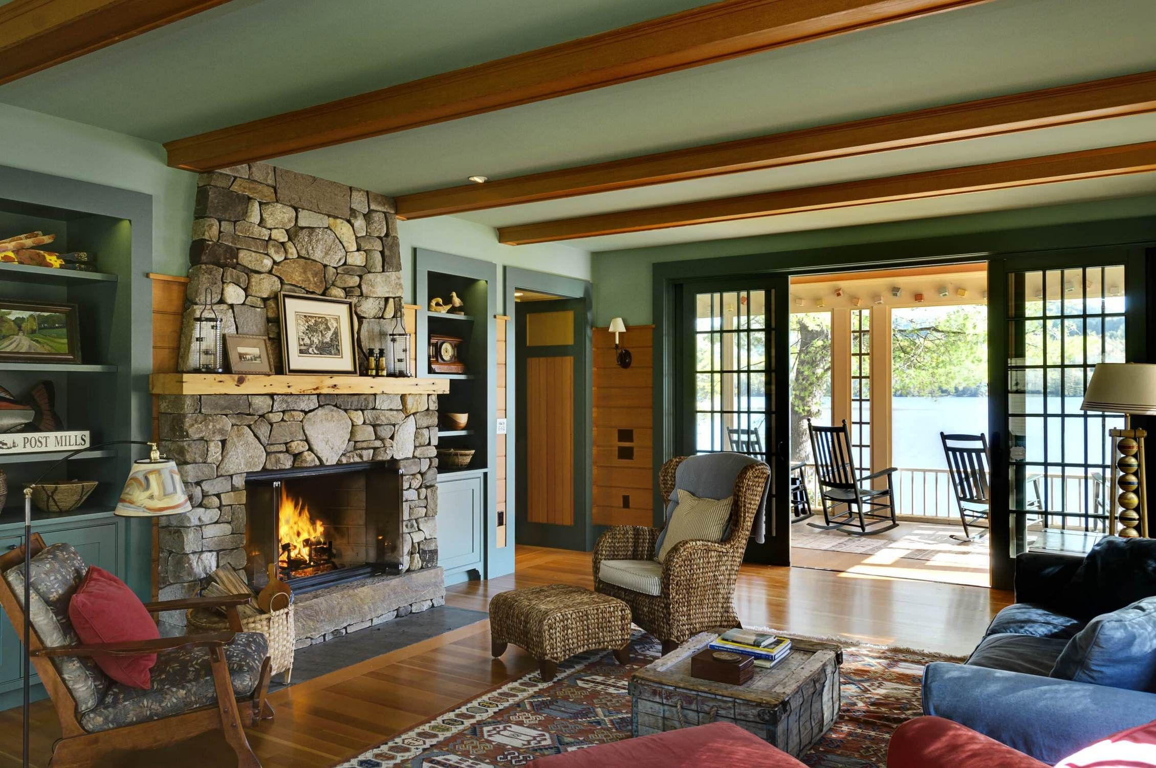 Warm Living Room With Cozy Sofa And Rattan Lounge Chair Also Stone Fireplace Built In