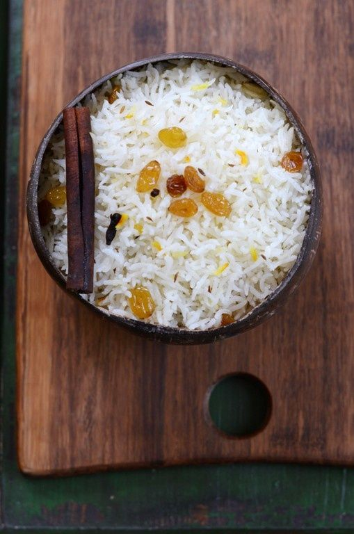 Fragrant Coconut Basmati Rice    Ingredients:   2 cups basmati rice  4 tablespoons canola oil   2 3-inch each cinnamon sticks  8 whole cardamon pods  8 whole cloves  20 whole black peppercorns  Few strands of saffron  1/4 teaspoon cumin seeds  1/2 teaspoon salt   2 cups light coconut milk  2 cups water    1 tablespoon canola oil  1/4 cup golden raisins #Home