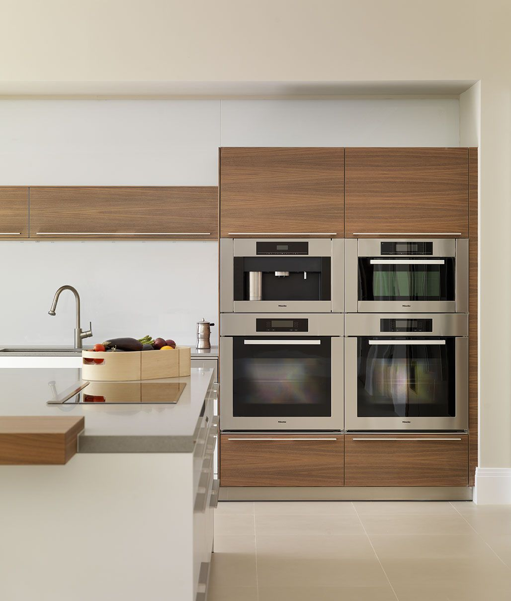 contemporary white and wood kitchen  block of Miele appliances