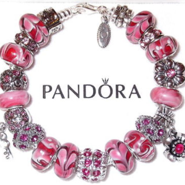 all the pink charms together on this pandora bracelet are