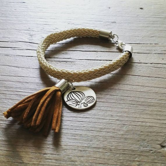 Check out this item in my Etsy shop https://www.etsy.com/uk/listing/244186942/elegant-bracelet-with-charm-and-tassle