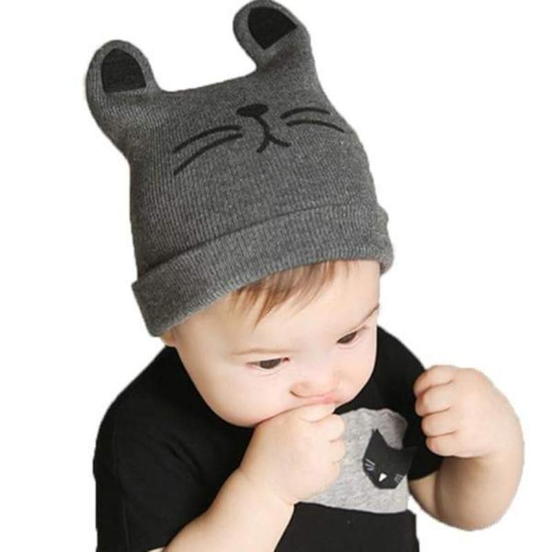 052a899c60f Let your little bunny feel snug as a bug wearing this cute beanie. It  features cute rabbit ear details and its mouth printed on the front. Made of  100% ...