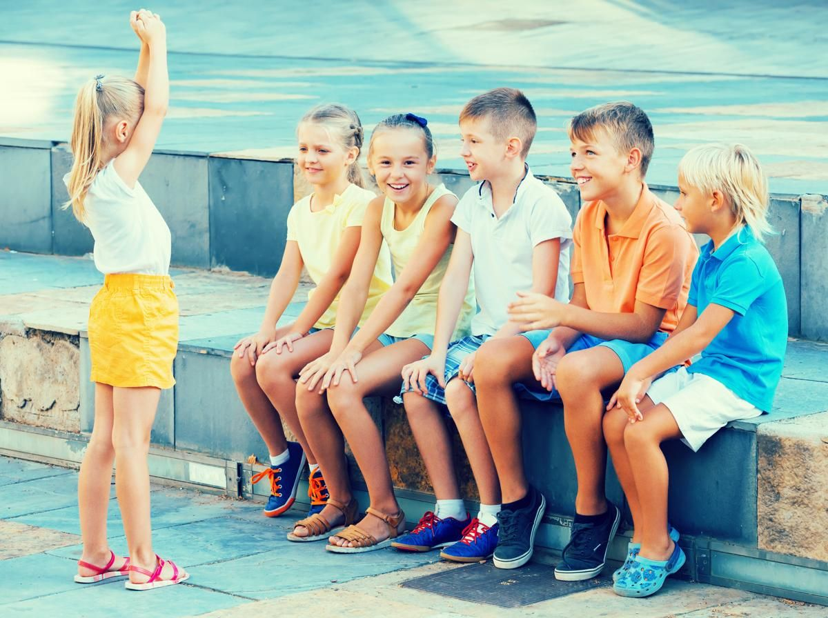 Cheerful kids playing charades outdoors | Icebreakers for kids, Fun  icebreakers, Kids playing