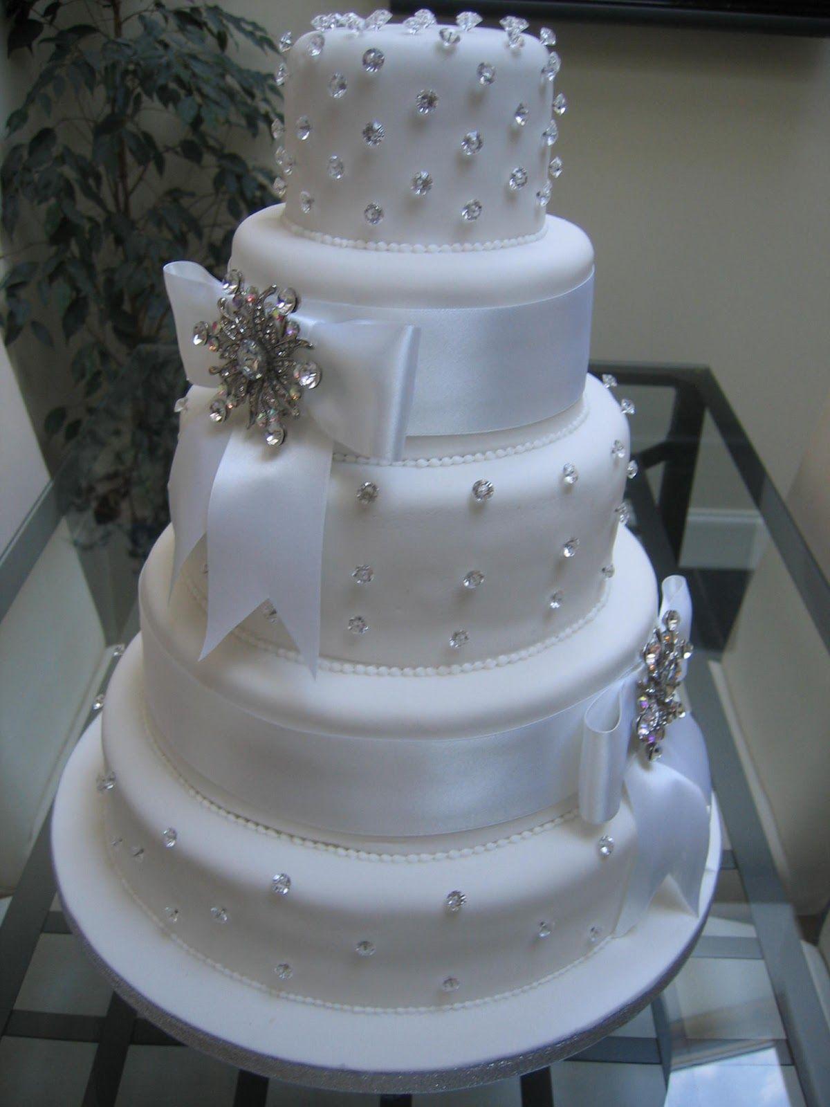 5 Tiered White Wedding Cake With Bling Bow Wedding Cake Bling Beautiful Cakes That Sparkle Shine Ideal Wedding Cake Designs Bow Wedding Cakes Bling Cakes