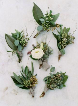 45+ Creative Wedding Greenery Ideas That Will Rock Your World - greenery groom boutonnieres made of olive greens leaves, eucalyptus leaves and berries.   #weddinggreenery #wedding #greenery #groom #weddingideas #greenerywedding #eucalyptuswedding #olivewedding #greenwedding #boutonniere #weddingdetails #weddingflowers #weddingdecor