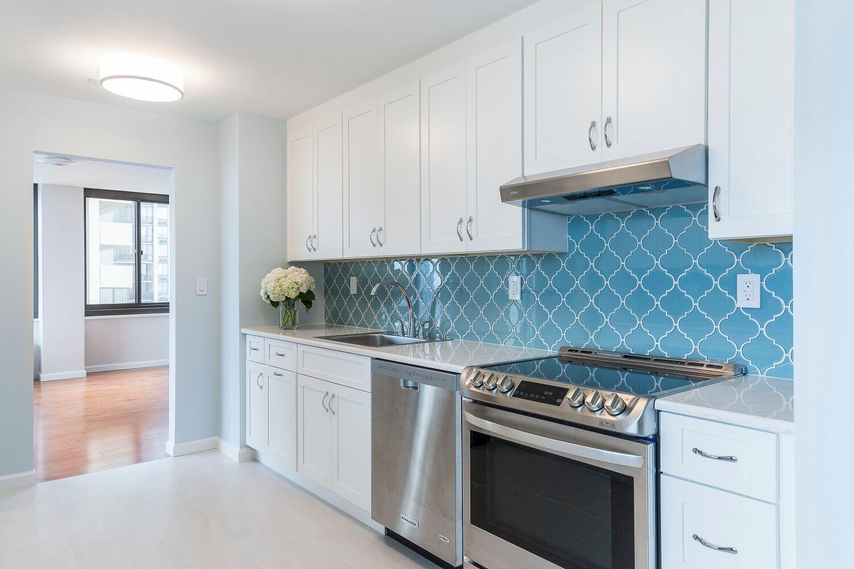 White shaker kitchen + glass arabesque backsplash tile. Interior ...