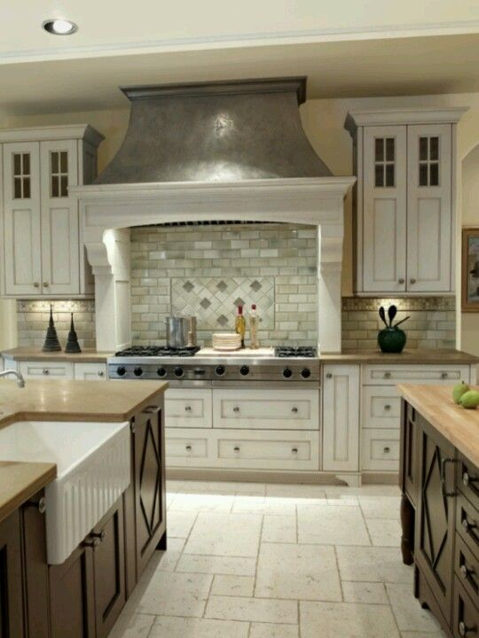 Two Colored Cabinets And Travertine Flooring Things To