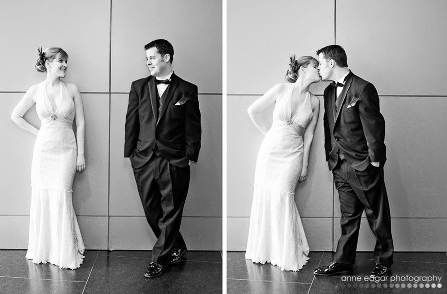 maybe looking around a corner of the wall (bride and groom)
