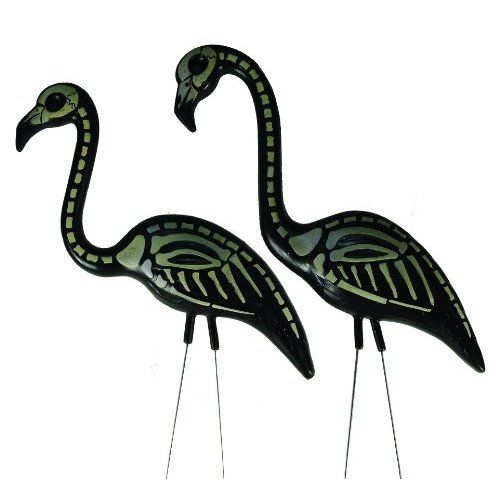 Best Scary Outdoor Halloween Decorations -- or paint this pattern on the pink flamingos with glow in the dark paint!