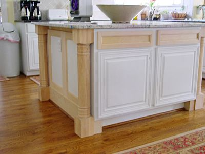 Kitchen Island From Stock Cabinets legs and trim added to an existing island | furniture/cabinets
