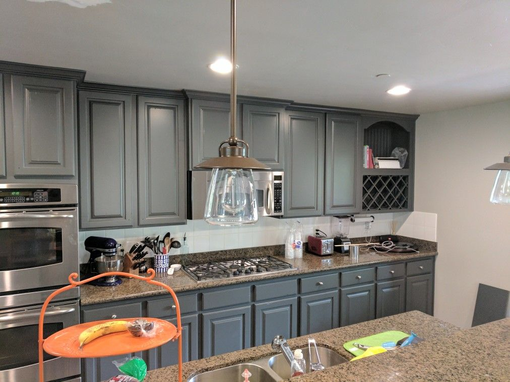 Kitchen Cabinets Refinished In Carbon Copy Gray By Chameleon Painting Utah.