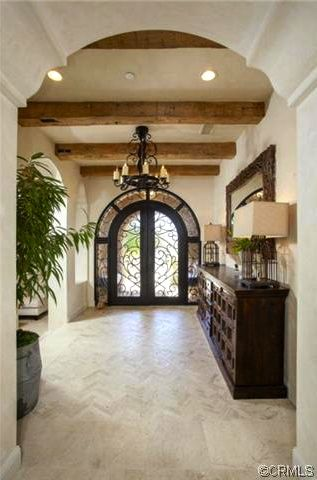Foyer wooden beam ceiling cast iron frames sideboard for Arched ceiling beams