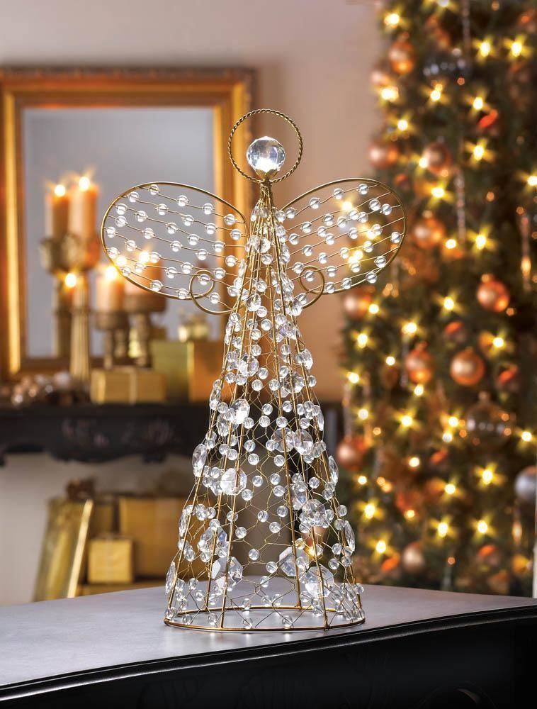metal beaded angel 18 tall christmas decoration the golden wire frame and the crystalline beads of this stylized angel capture common light and turn it