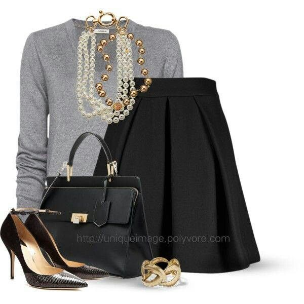 Who would wear this outfit to work? We love the pleated skirt paired with a classic sweater. You can also never go wrong sporting some pearls.