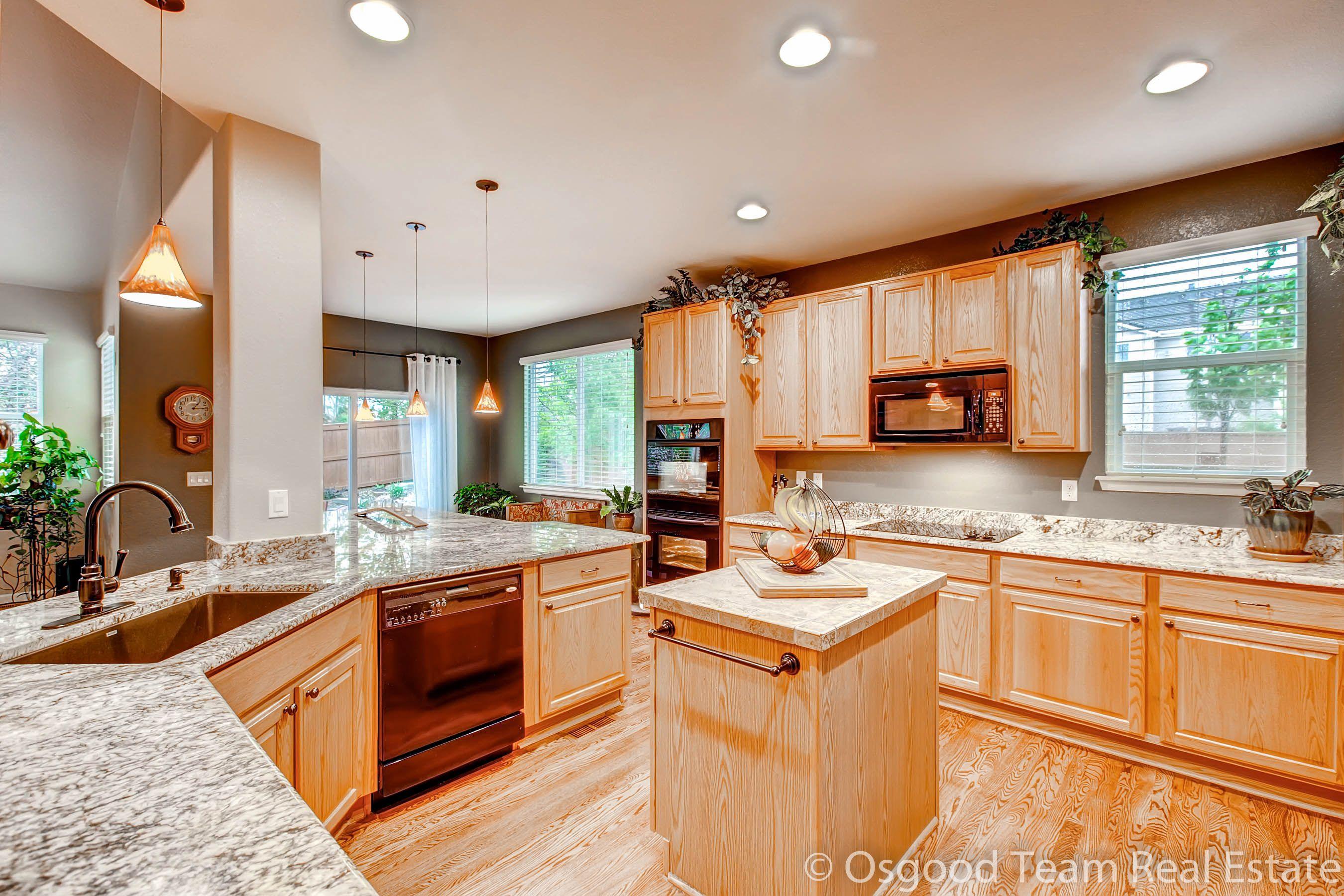 updated kitchen in parker colorado slab granite center island