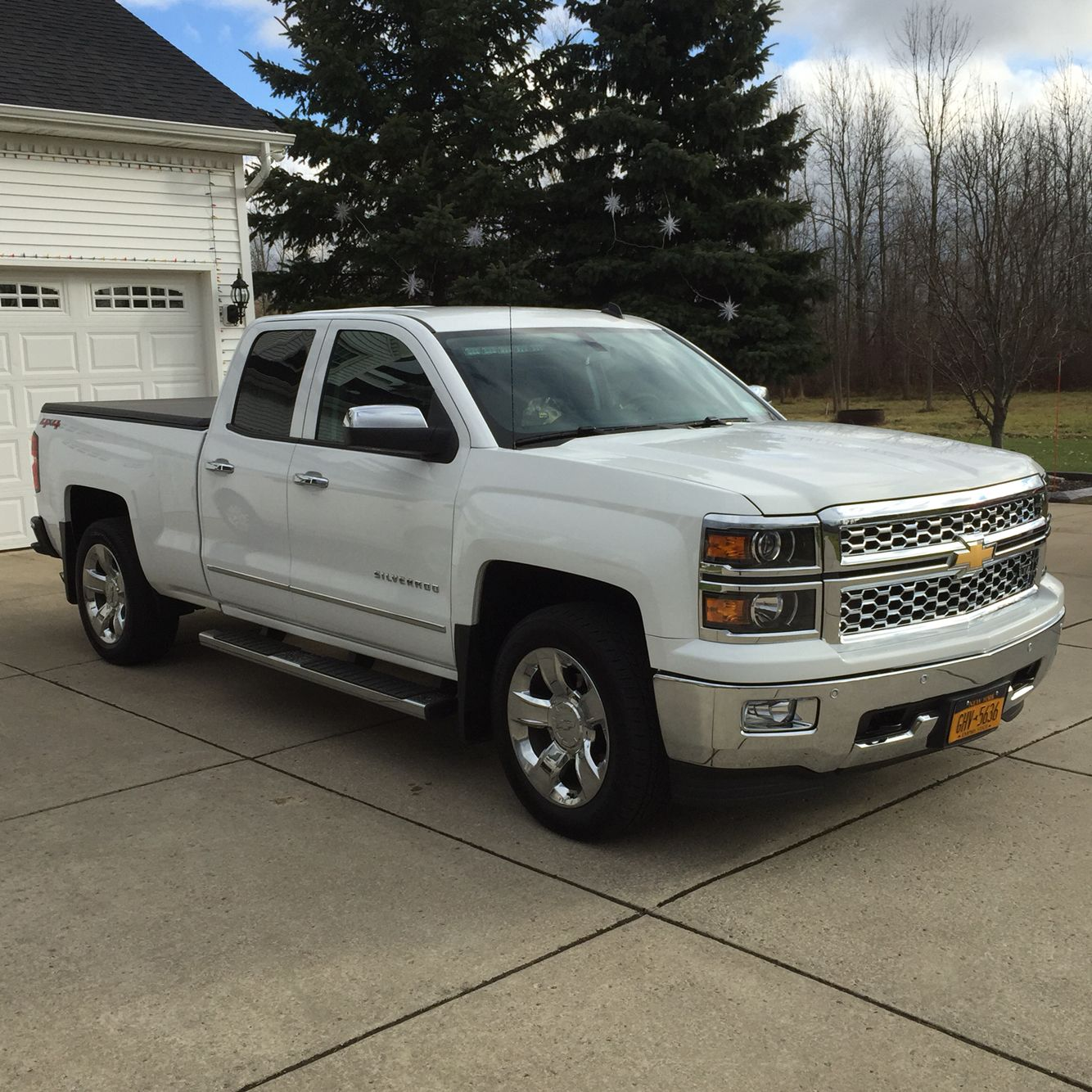 My new sexy white chevy silverado 1500 ltz double cab with chrome accents and 20