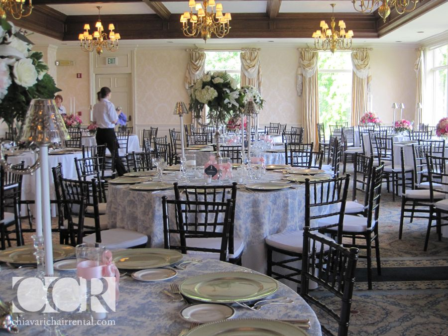 Mahogany Chairs Paired With Silver Chargers