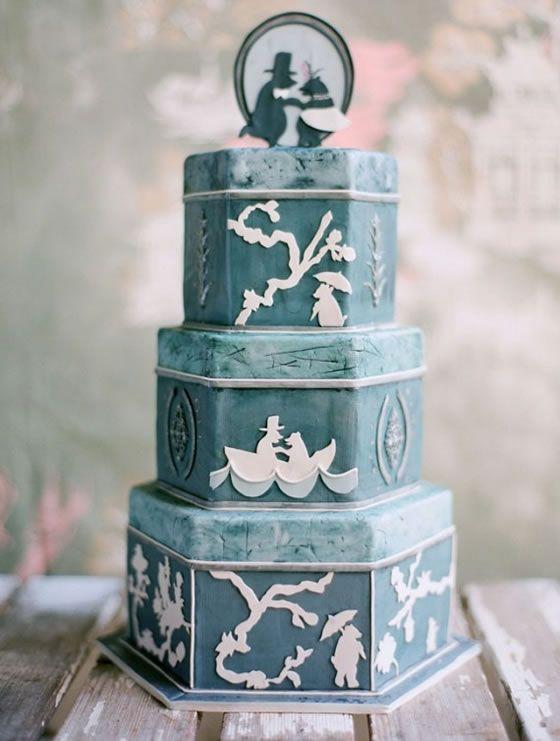 A dusty blue wedding cake.