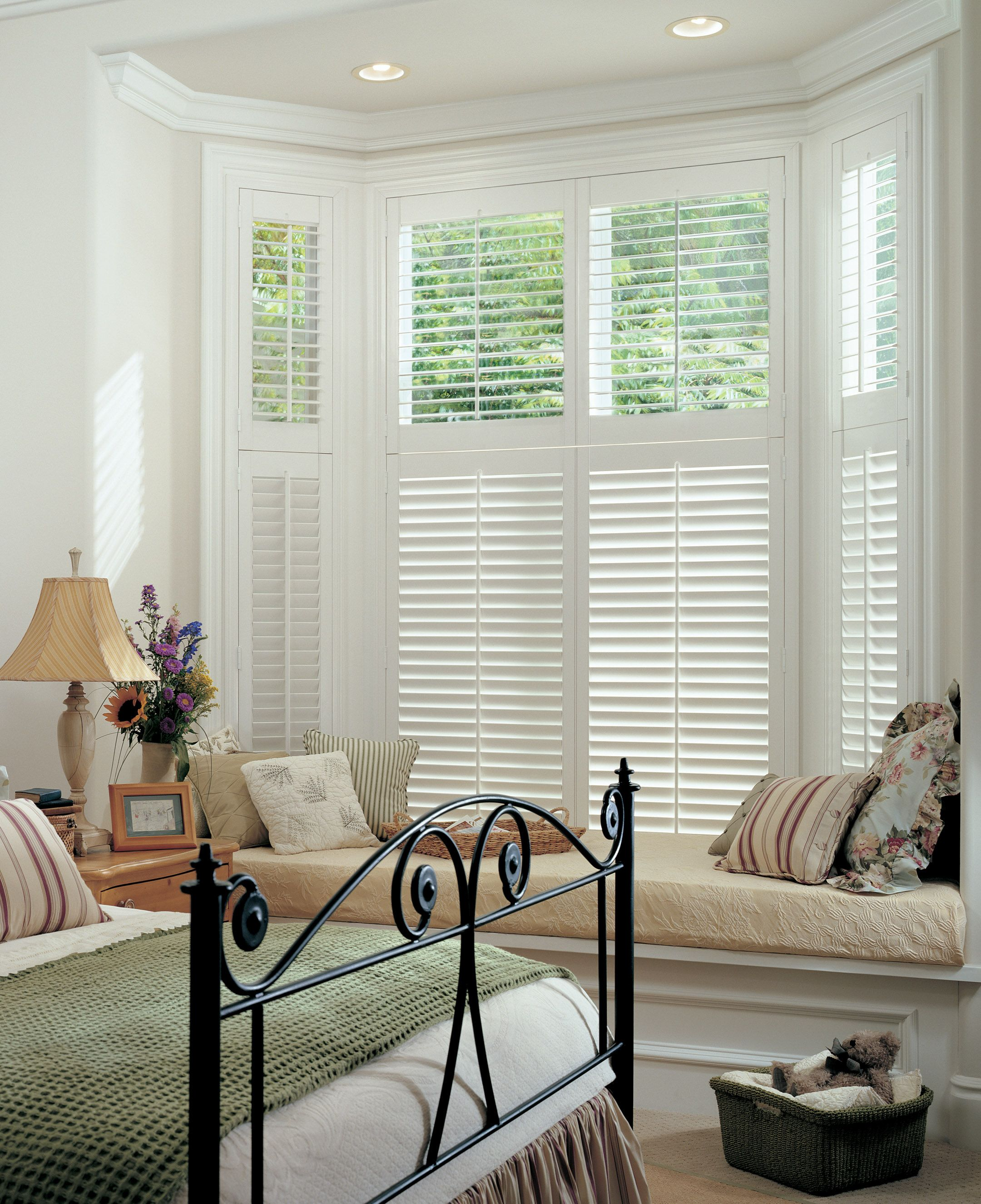 Two Tier White Wood Shutters Blend Perfectly In This Period Home