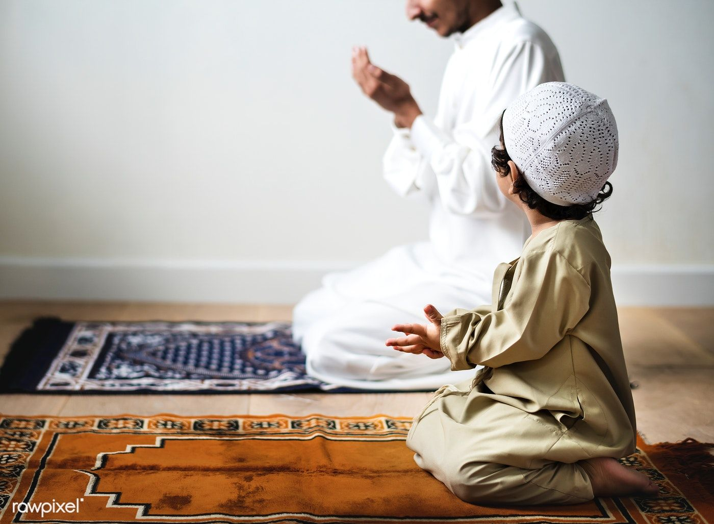 Download premium image of little boy praying alongside his father during #quotesaboutlittleboys