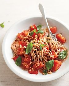 A no-cook tomato sauce is all about allowing the different ingredients to soak up one another's flavors. Let this one sit for at least an hour -- even three, if you've planned ahead. If your tomatoes are super ripe, skip the knife and tear them to pieces with your hands. (Whole-wheat noodles can sub in for the farro ones.)