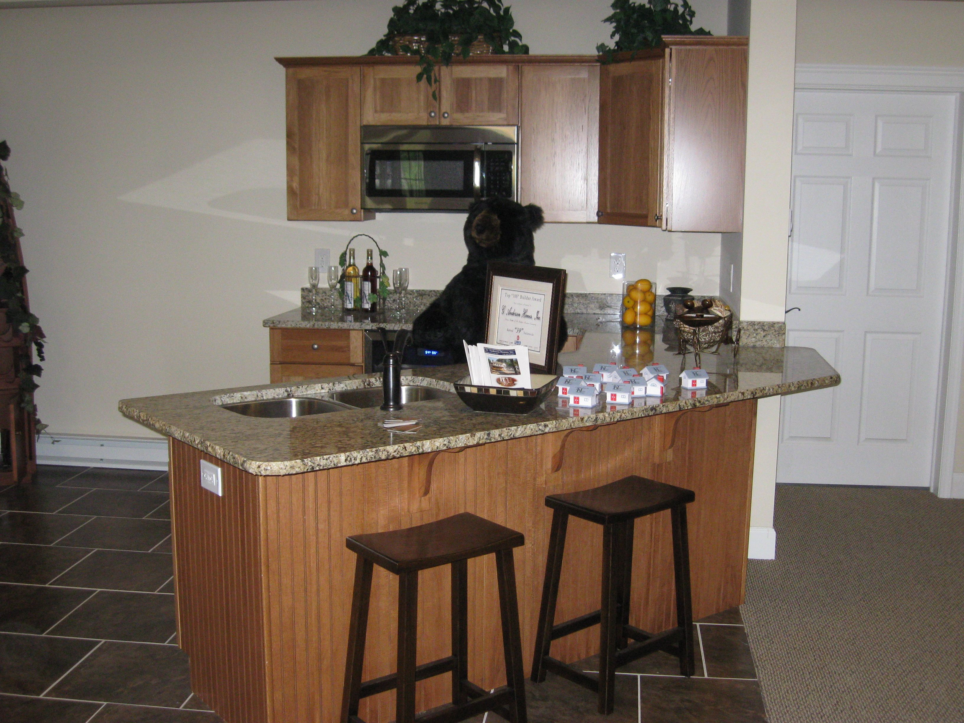 Legacy Cabinetry   Hickory Wood   Medium Stain   Granite Santa Cecilia Top.