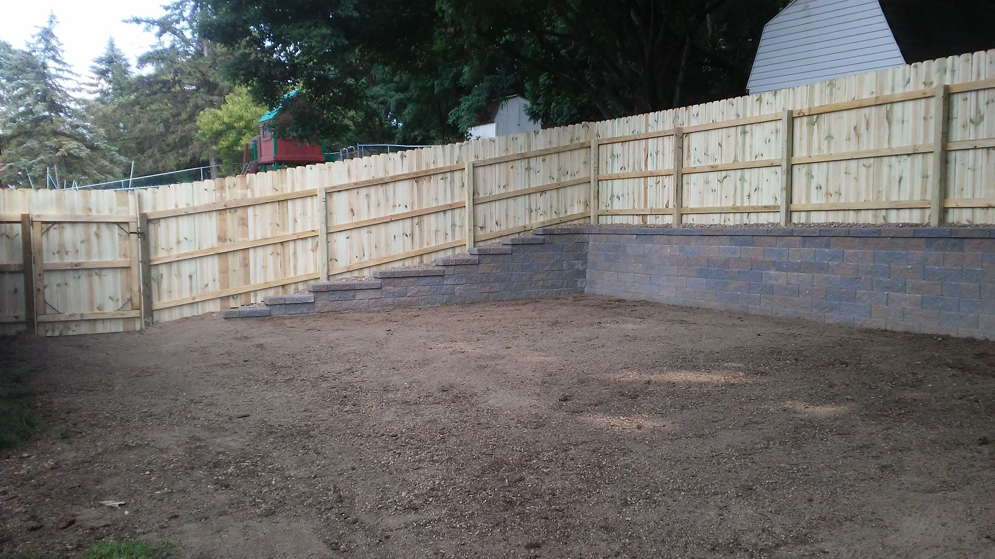 Yard Leveled Out Versa Lok Retaining Wall And Privacy Fence 2 Bamboo Fence Backyard Fences Sloped Backyard