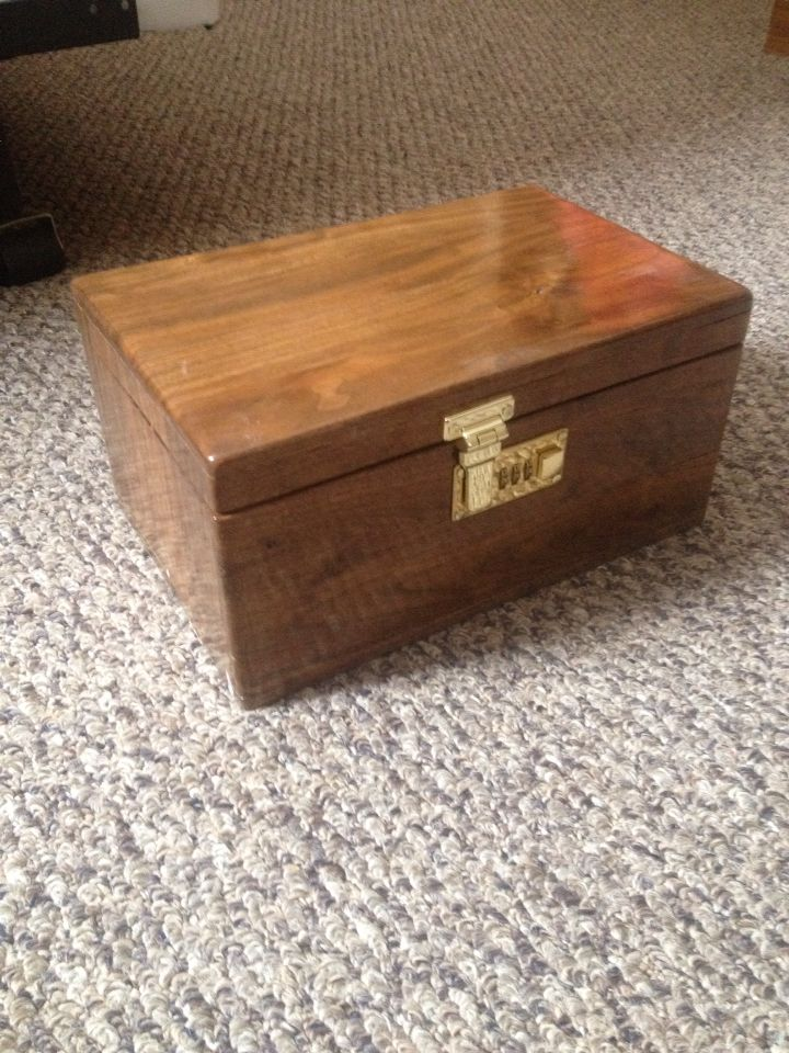 A lock box that I made from a Walnut log and used a briefcase lock.
