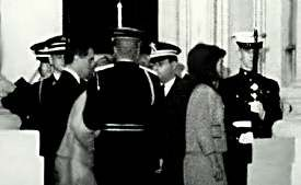 Jackie Kennedy follows her slain husband's coffin into the White House