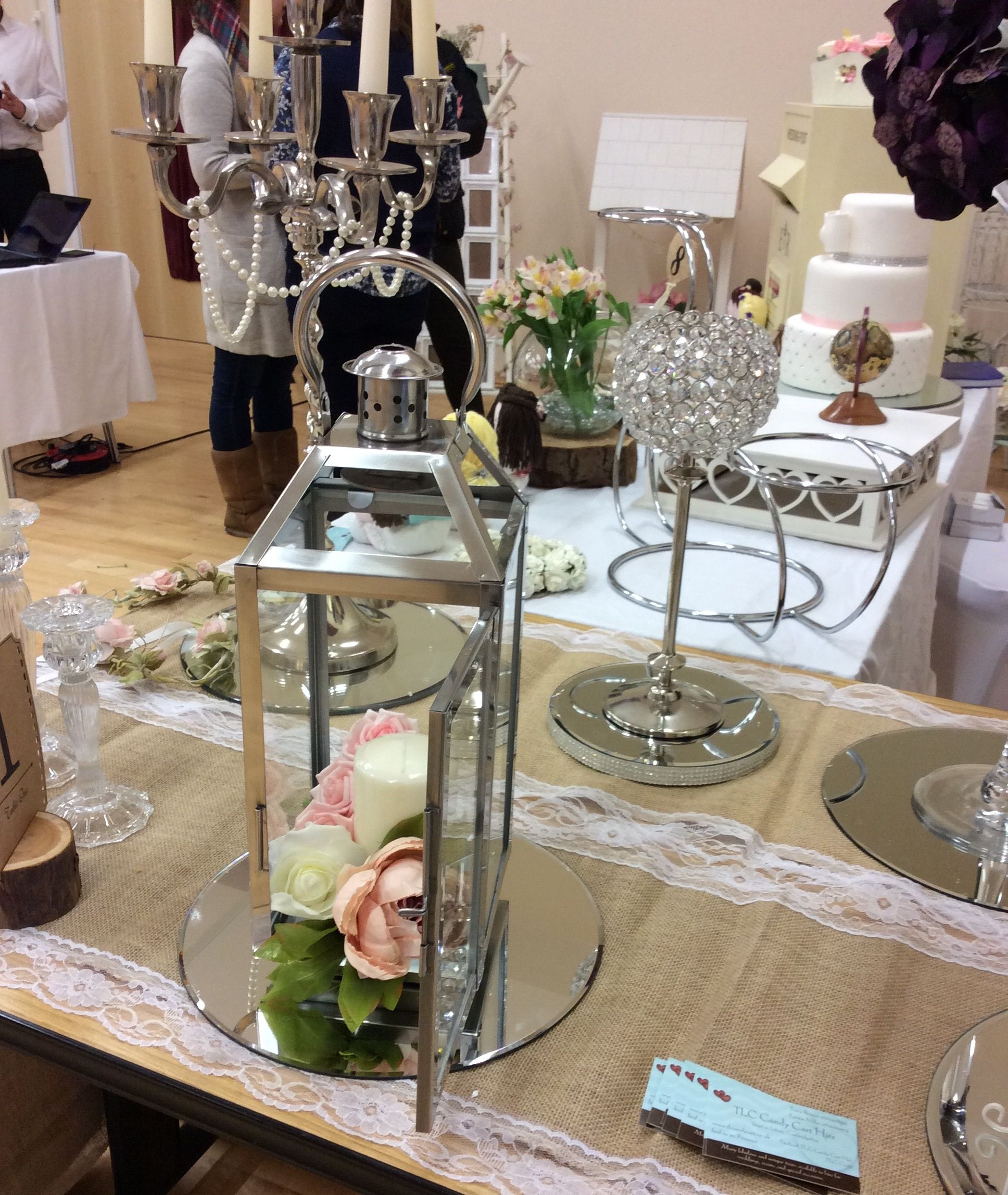 Gorgeous centrepieces for hire stainless steel lanterns £7 per lantern hire fee large pillar candles £2 extra wedding hire based in cambridgeshire