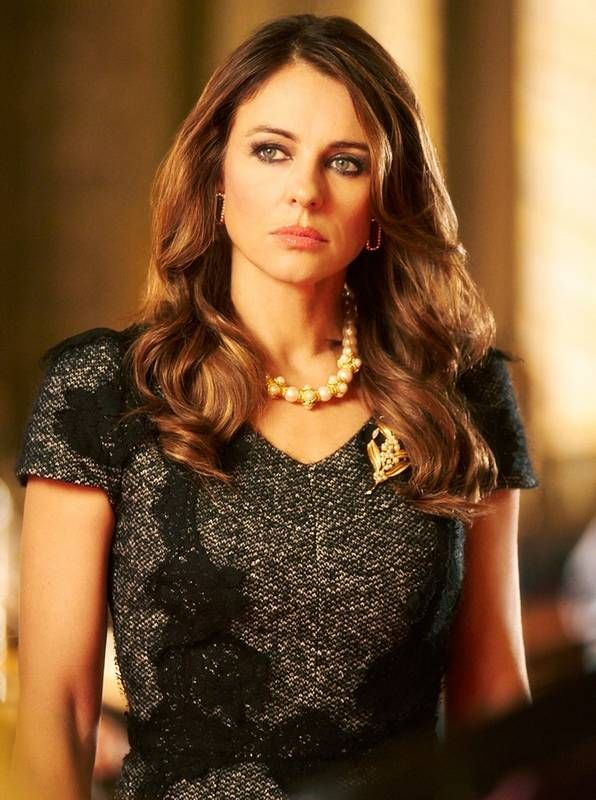 "Elizabeth Hurley plays Queen Helena, the Queen of England in a new TV drama series ""The Royals,"" which is currently filming and being set in London. The show is due in early 2015."