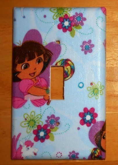 Dora the Explorer Light Switch Plate Cover  Handcrafted. No two are alike.  Positioning of Pattern may vary.   Easy to clean with a damp cloth.  Mounting screws included  Other size covers available.