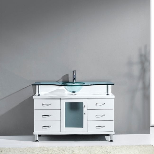 Enrich your bathroom with this clean white bathroom vanity. Featuring generous soft closing drawers and door, this attractive vanity combines fashion and function.