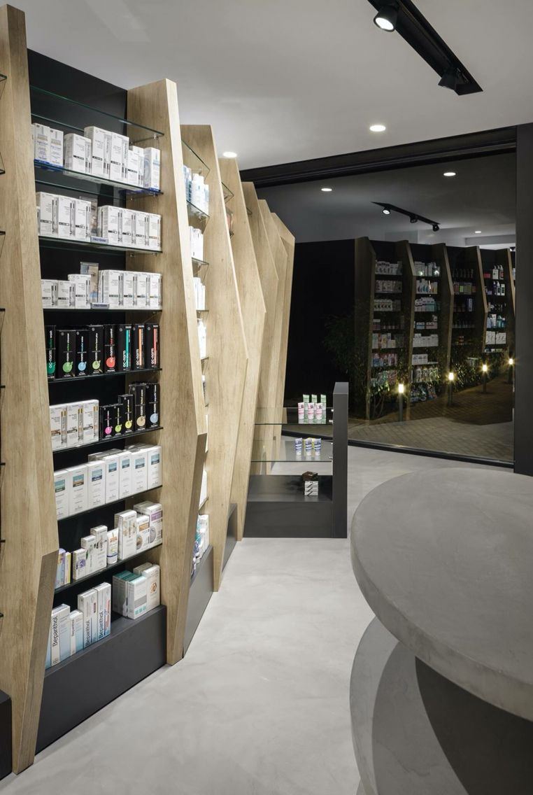 cure and care pharmacy shop athens pharmacy design retail design store - Pharmacy Design Ideas
