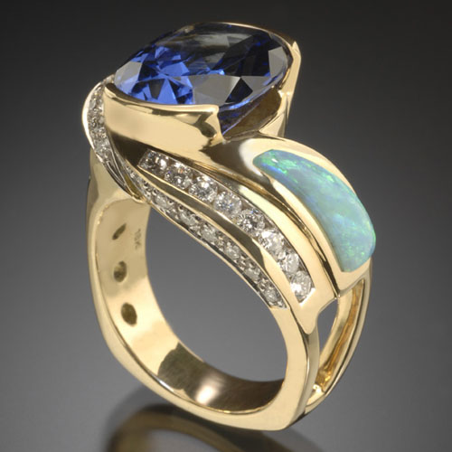 RANDY POLK DESIGNS: A very rare 8.3 ct. Tanzanite center stone w/pillow cut Australian Opal, channel-set and pave' Diamonds.