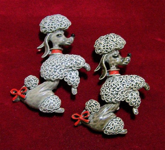 Vintage Gerrys pair of gray painted enamel poodle brooch Grey is highlighted by red ribbon and collar, black eyelashes and nose 2 inches high x 1 1/2 inchces wide Signed on back Gerrys You will receive both poodle pins, to wear together or keep one and give one Very good vintage condition, shows no wear I specialize in vintage figural animal jewelry, please visit my shop for more selections International buyers welcome, I can ship 3 jewelry items for 12$ USD, overcharges are refunded Pri...