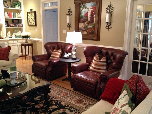 Two Leather Reclining Club Chairs Face The Fireplace Metal Round Side Table Sits Between
