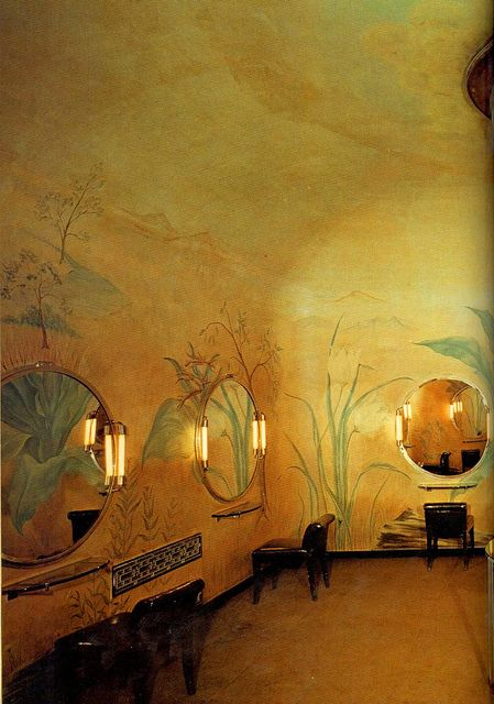 """""""The women's lounge on the first mezzanine at Radio City Music Hall, New York. The painted wall decorations are by Yasuo Kuniyoshi, who was born in Japan in 1893. . .""""    Klein, Dan. Art Deco. London: Treasure Press, 1984."""