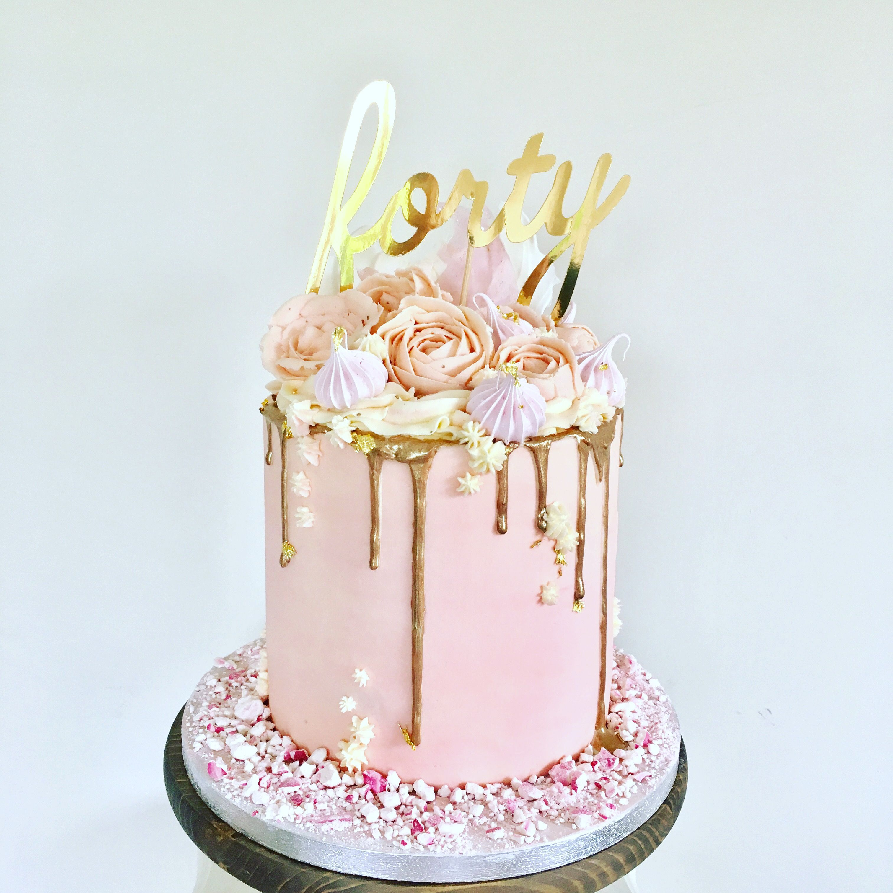 Pink Buttercream Cake With Buttercream Flowers Including Roses And