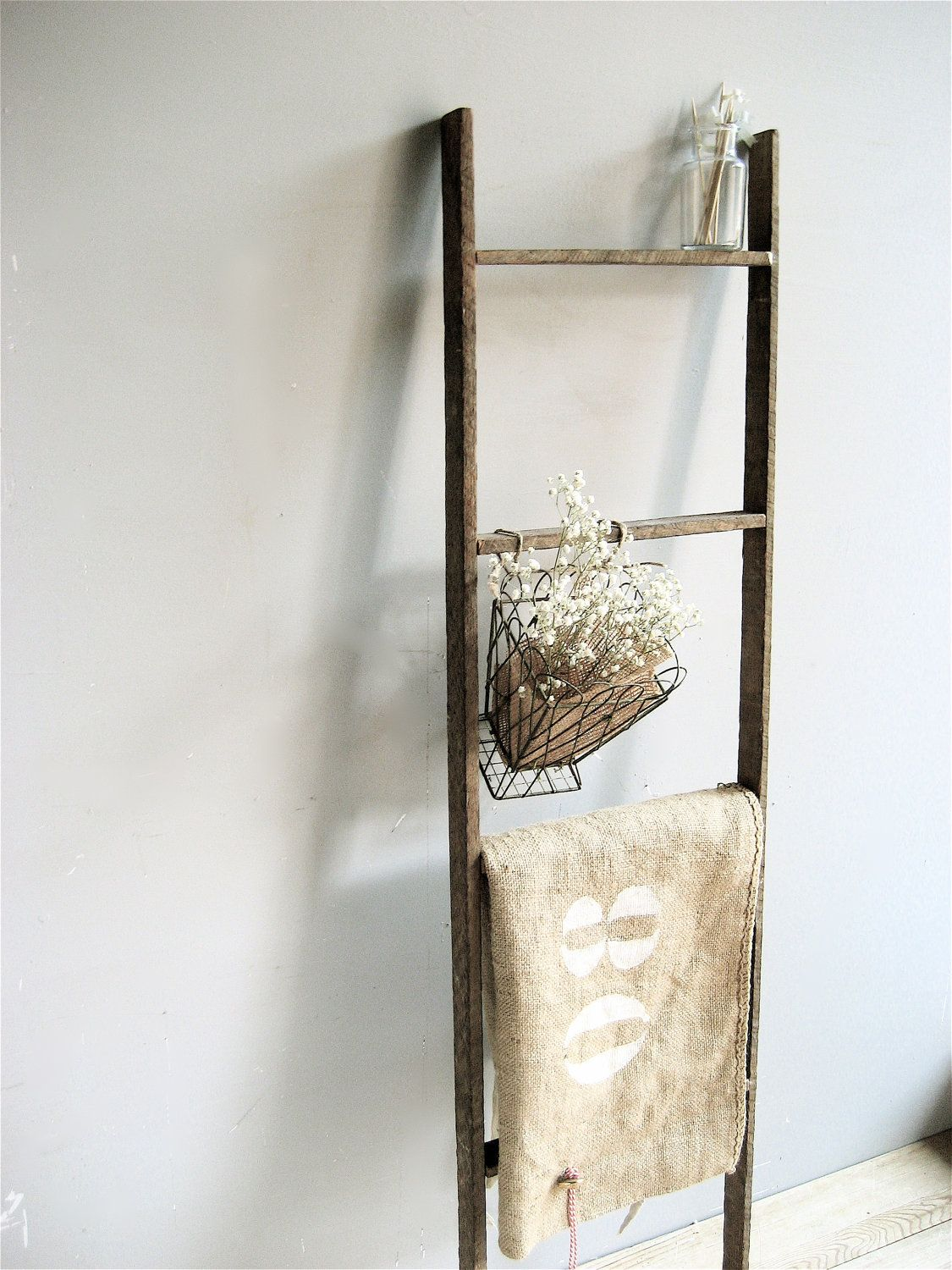 Primitive weather wood ladder. Not heavy so is easy to hang, or it ...