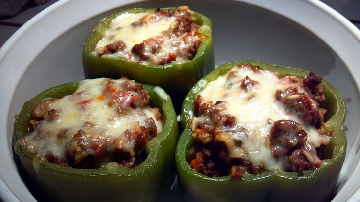 """Stuffed  Bell Peppers! """"I found some HUGE bell peppers so I decided to try this recipe. I seasoned the meat with black pepper and garlic powder, also added a little more onion than it called for...it turned out great! I only made two large peppers, ending up with extra meat filling left over...would be a great calzone or turnover filling!""""  @allthecooks #recipe #beef #easy #peppers #stuffed #hot"""