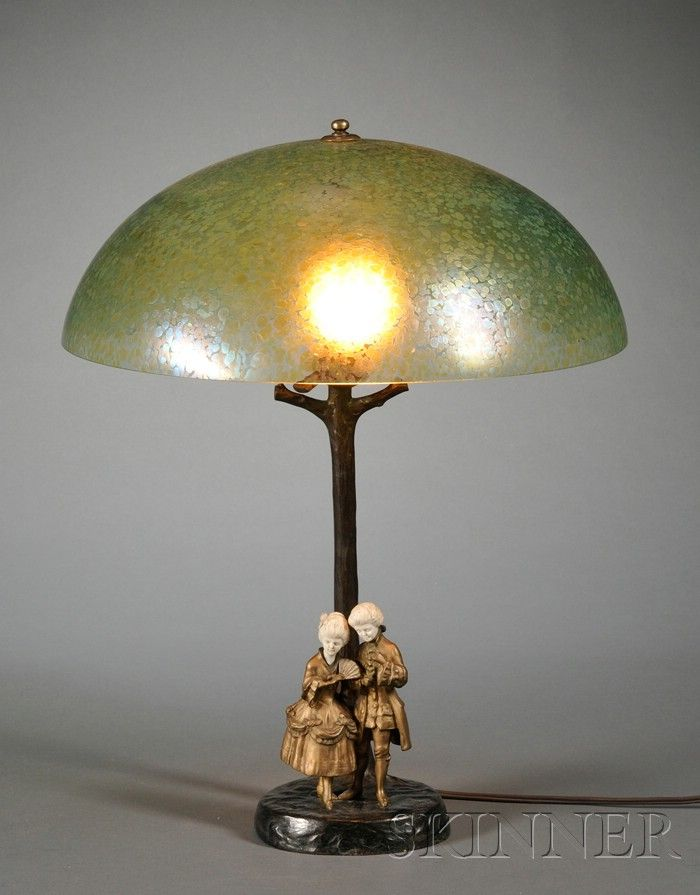 Table Lamp Bronze Ivory And Art Glass Domed Iridescent Green Oilspot Shade In The Manner Of Loetz Supported On A Rust Art Deco Table Lamps Table Lamp Lamp