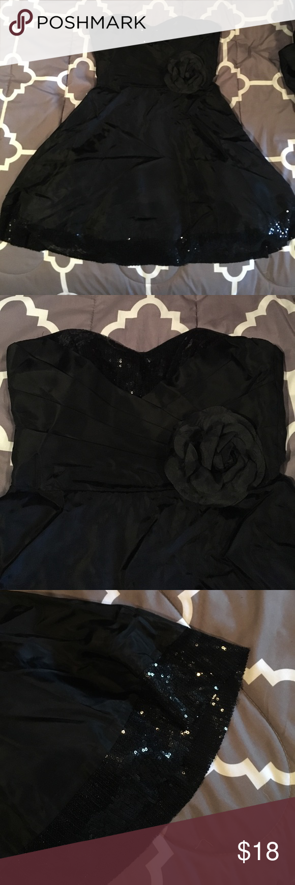 Short black dress Beautiful strapless black dress adorned with sequins at the top & at the dress's bottom. Like new - worn once to a homecoming dance. Perfect condition (it's just a little wrinkled). Purchased from Windsor. Windsor Dresses Strapless