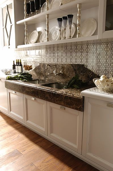 Exceptionnel Emperador Dark Marble Countertop With Unique Backsplash And Faucet Coming  Out Of The Wall.