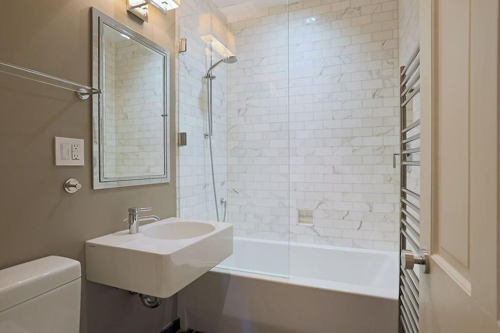 Contemporary Full Bathroom with tiled wall showerbath, Handheld showerhead, Wall mounted sink, High ceiling