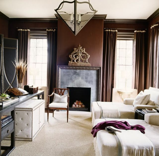 Rich chocolate brown walls  drapery with creamy furnishings