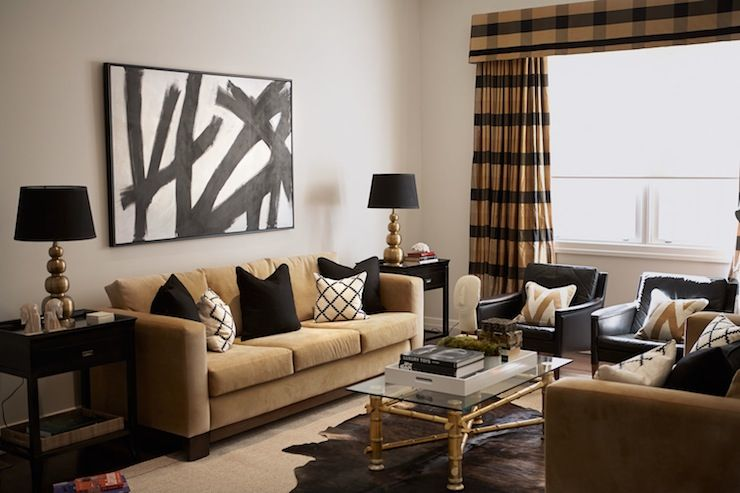 Black And Gold Living Room With Black And White Abstract Art Over