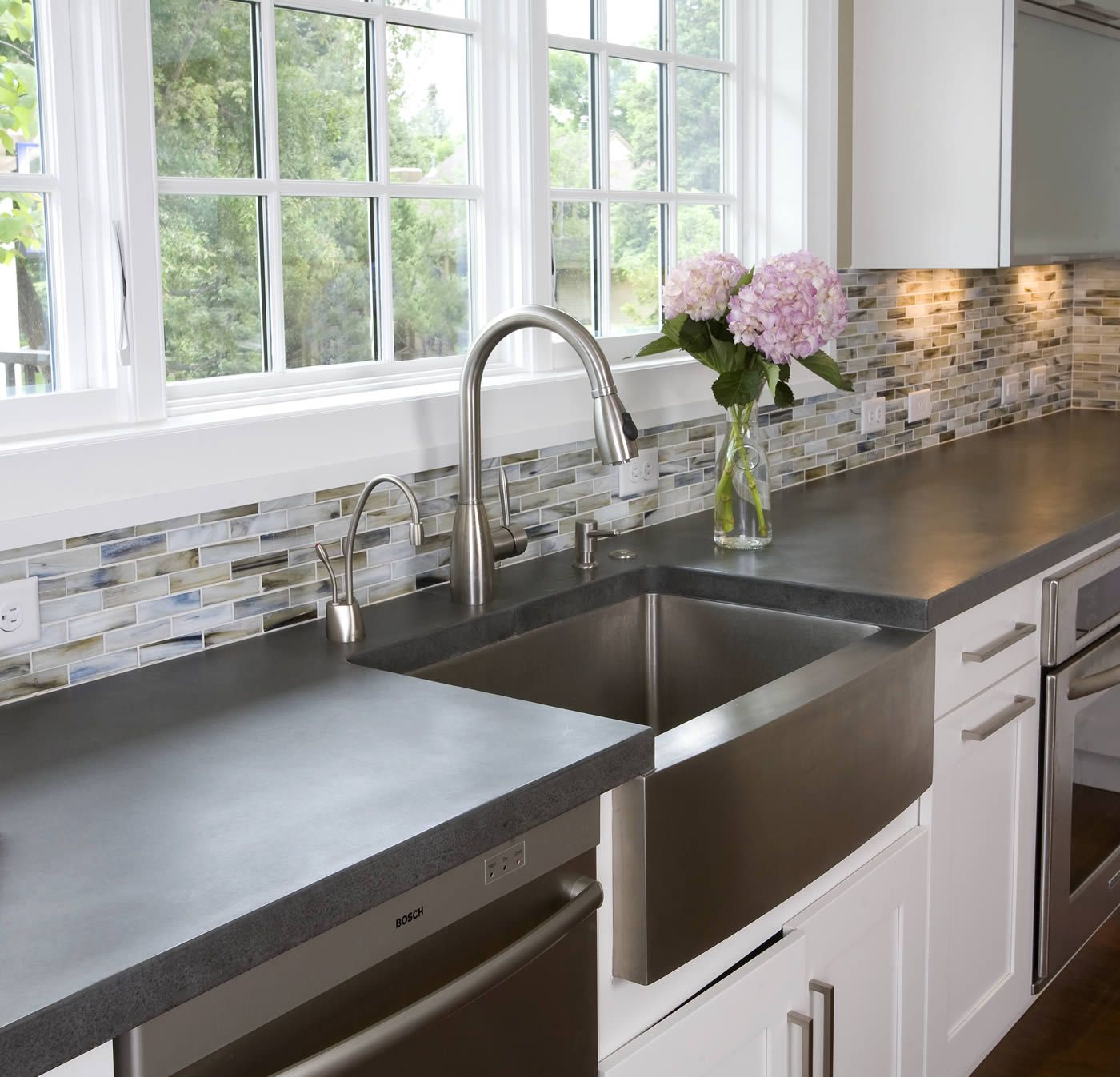 silver apron sink plus faucet on white kitchen cabinet with grey ...