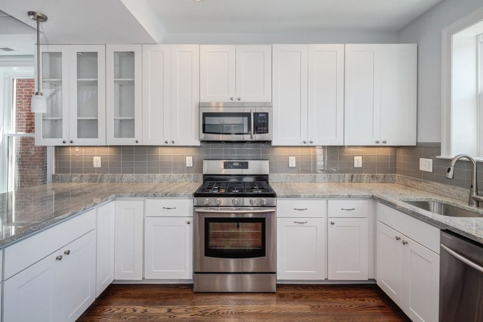 white cabinets, light counters